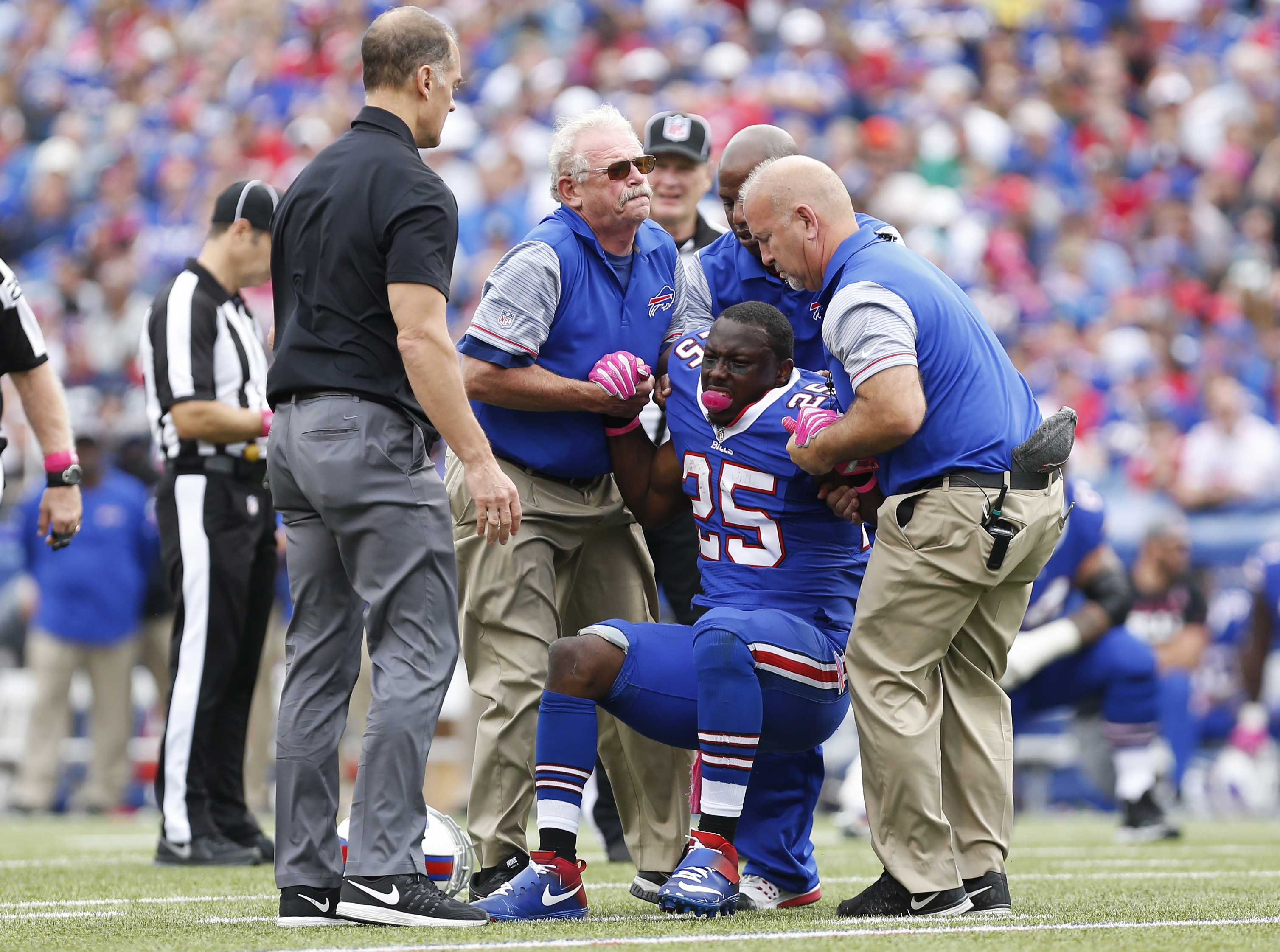 Oct 16, 2016; Orchard Park, NY, USA; Buffalo Bills running back LeSean McCoy (25) is helped to his feet after being injured during the first half against the San Francisco 49ers at New Era Field. Mandatory Credit: Kevin Hoffman-USA TODAY Sports