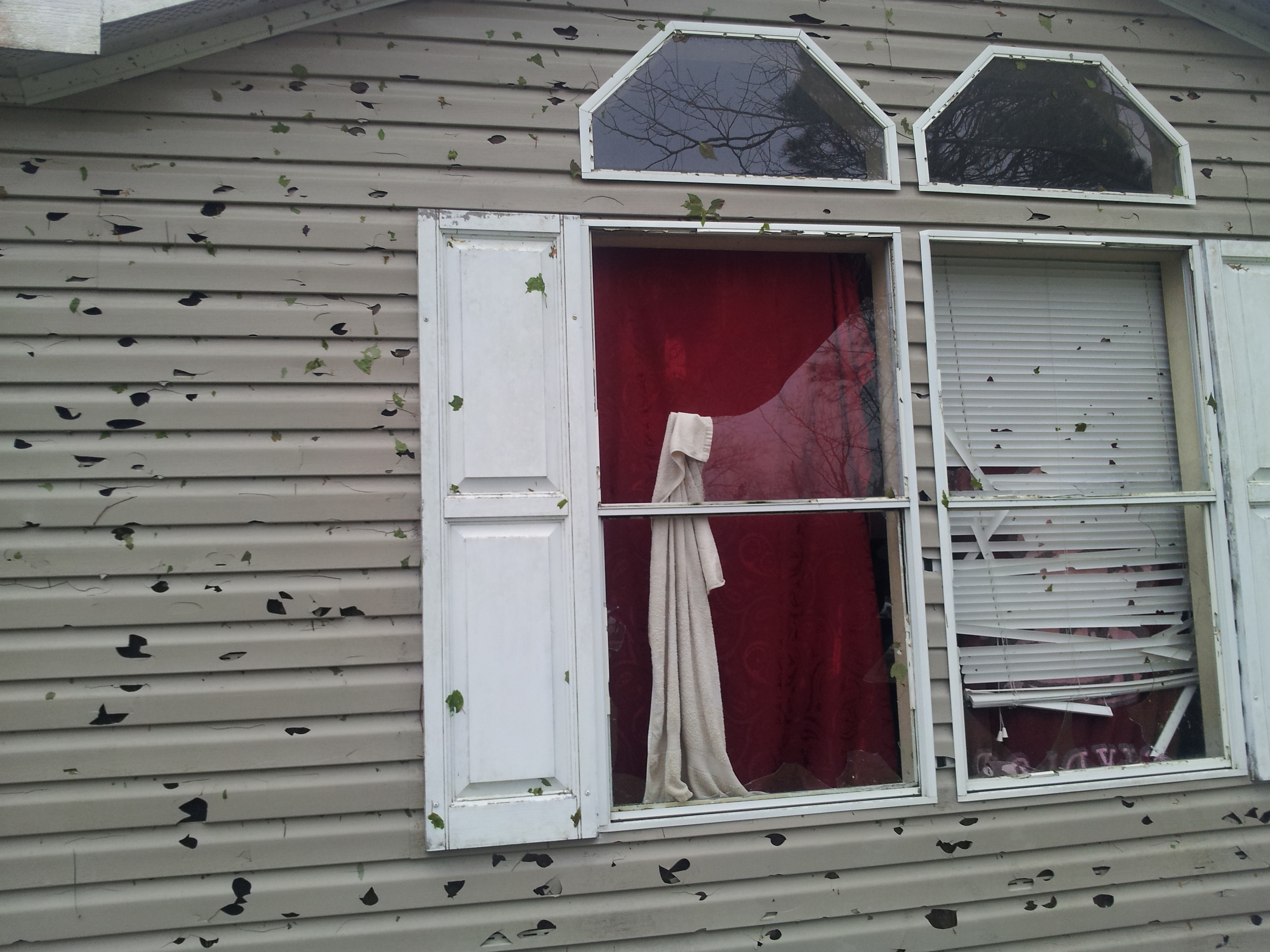 Another view of the hail damage to a mobile home in Lawtey.