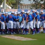 The team huddle at the start of the Gator Baseball game against Cal State Fullerton.