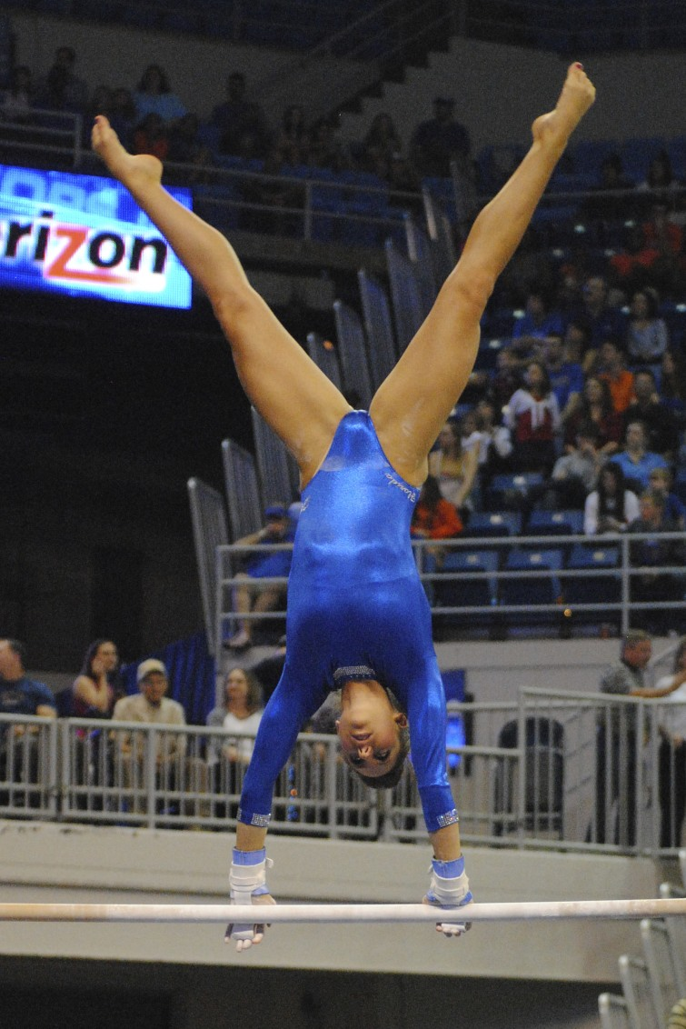 Alaina Johnson took home the score of a 9.90 on bars friday.