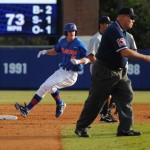 Senior Daniel Pigott makes it safely to second base.