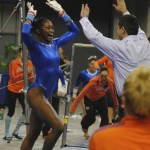 Ashanee Dickerson celebrates her score of a 9.875 for bars.
