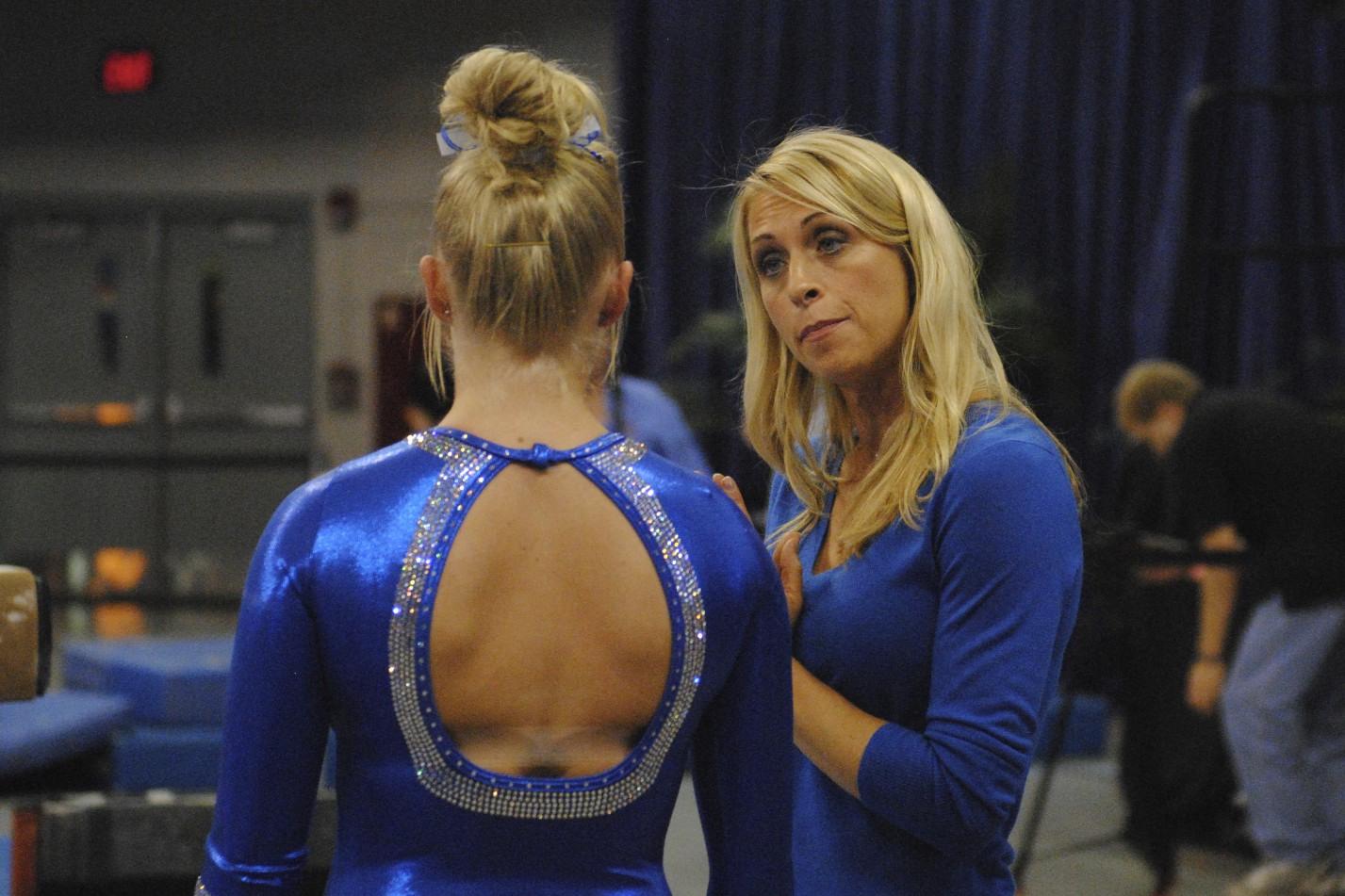 Head Coach Rhonda Faehn prepares freshman Rachel Spicer for her beam routine.
