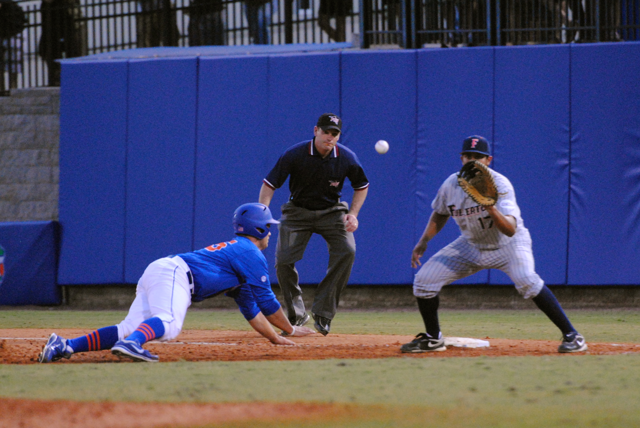 Tucker safely dives back to first base after leading off.