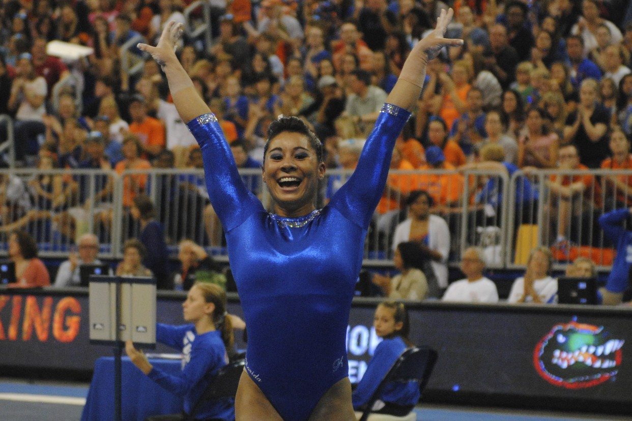 Junior Marissa King after she sticks her landing for the highest Florida score on beam, a 9.95.