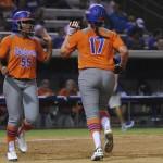Teammates Briana Little and Lauren Haegar keep spirits high after an out.