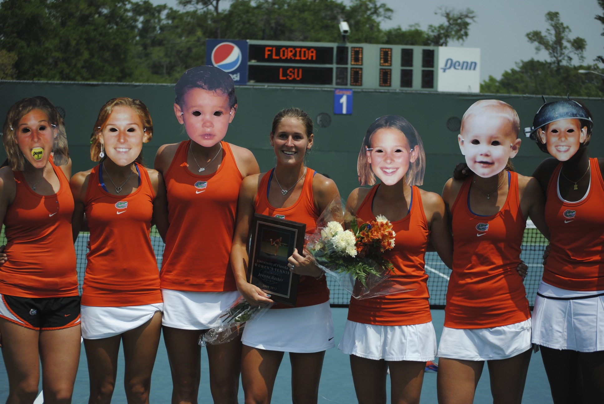 The Florida Women's tennis team celebrates Joanna Mather's Senior day prior to the match wearing masks of the Senior at different stages of her playing career thus far.