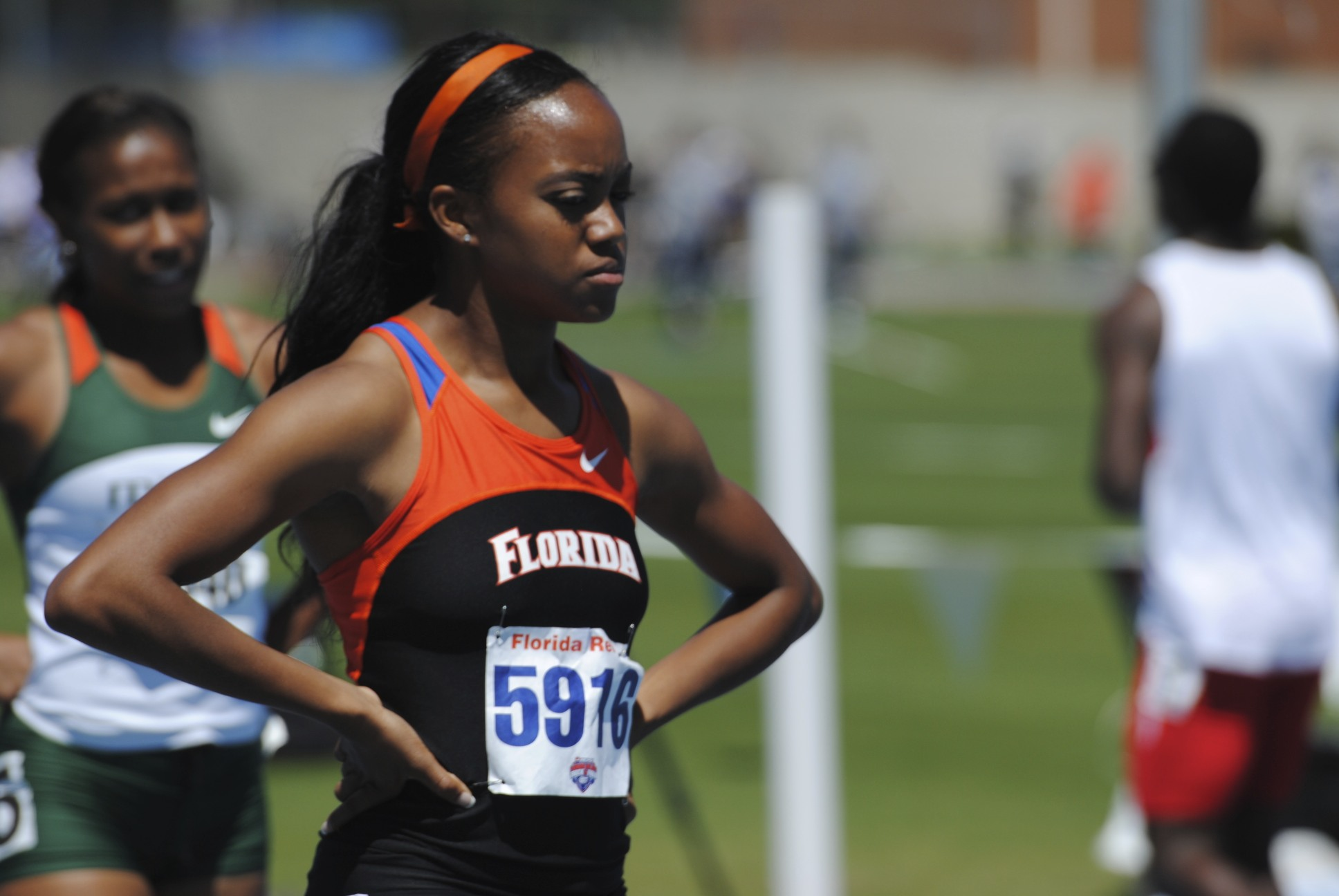 Junior Michelle Stegal finishes the 400 meter dash.