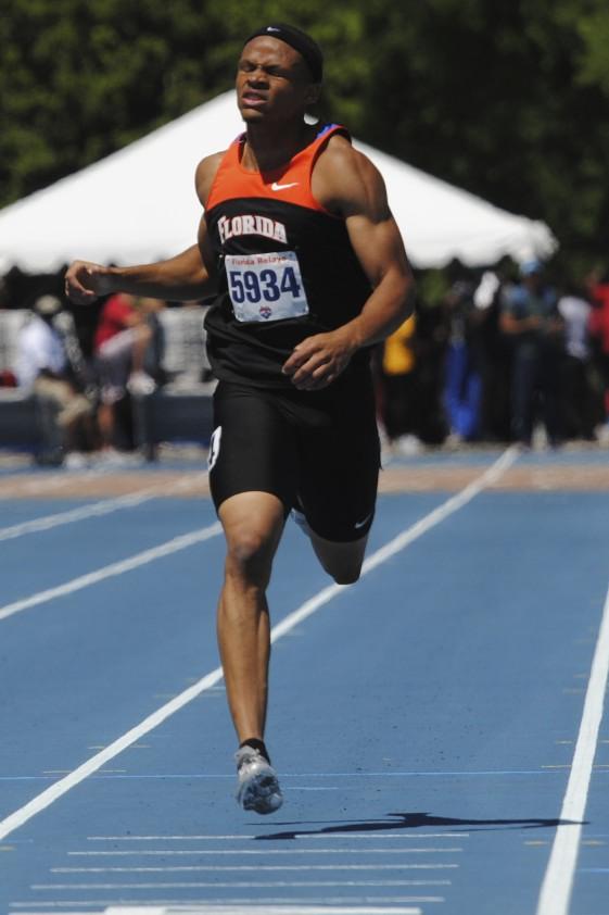 Freshman Hugh Graham Jr. runs the 400 meter dash with a time of 46.93.