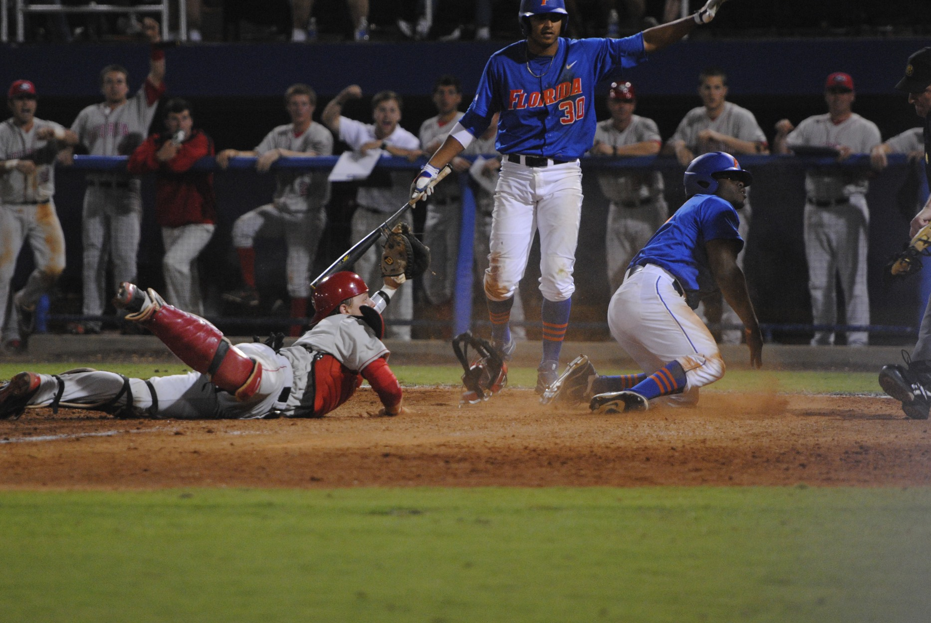 Freshman Josh Tobias tries to score for the Gators but is tagged out at home.