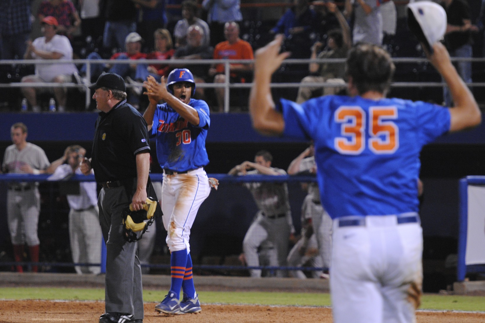 Vaskash Ramjit scores the winning run for the Gators at the bottom of the 16th inning Friday night.