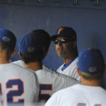 Head coach Kevin O'Sullivan talks to his team in the dugout after a tough loss to LSU Saturday afternoon.