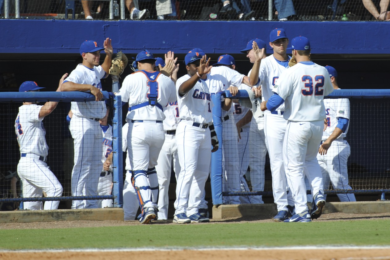 The Gators return to the dugout pleased with their performance early in the game.