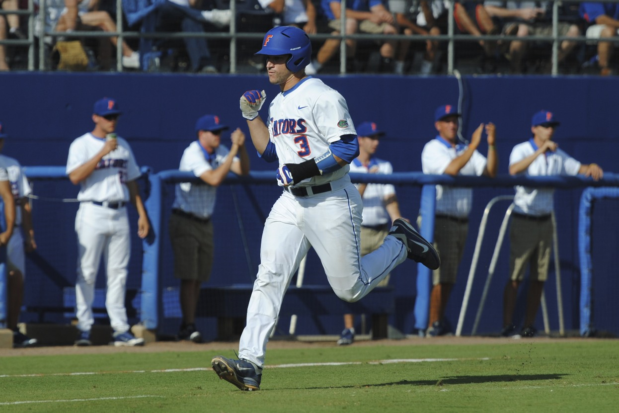 Mike Zunino scores one of the seven runs for the Gators on Saturday.