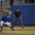 Senior Daniel Pigott leads off first base.