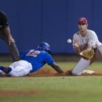 Josh Tobias slides back to first base.