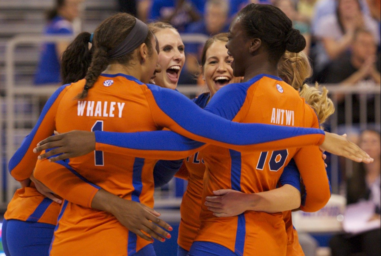 The Florida Gator Volleyball celebrates after winning an exhausting point.