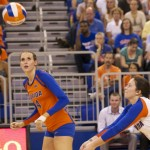 Libero Taylor Unroe passes a free ball as Besty Smith goes right side for a kill.