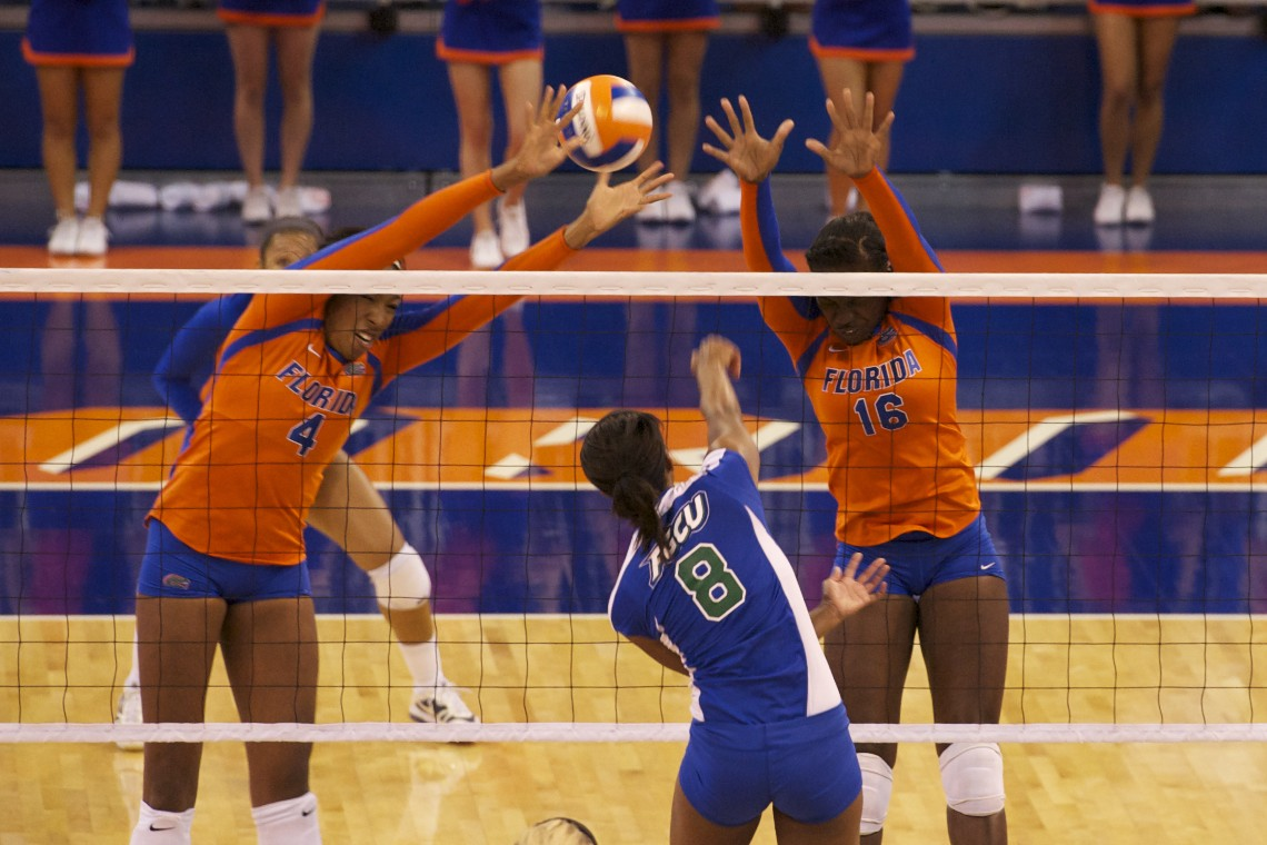 Senior Tangerine Wiggs and Freshman Simone Antwi attempt a block.