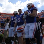 Florida captains Sharrif Floyd, Jeff Driskel, and Sam Robey walk out to flip the coin prior to the game.