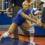 Freshman Gabby Mallette warms up before the match against Missouri Friday night.