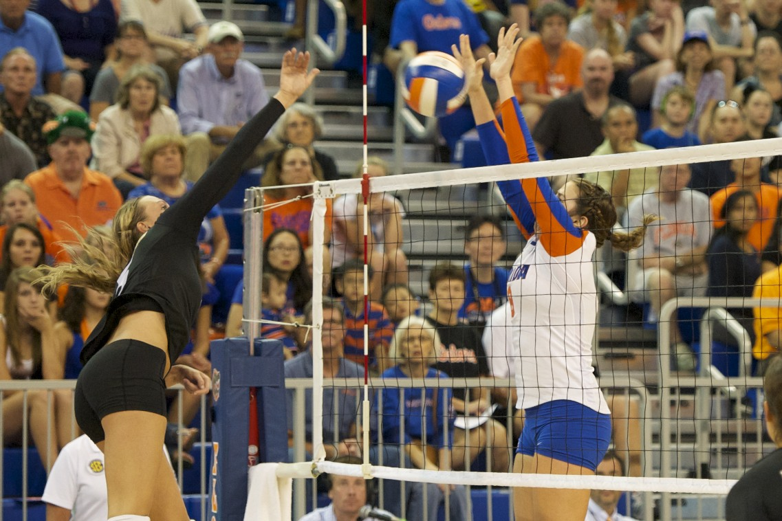 Setter Taylor Brauneis gets a block against Missouri in the first set, Friday evening.