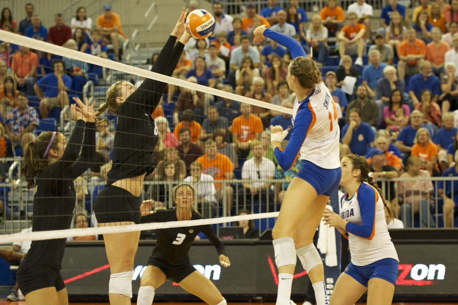 Senior Betsy Smith of the Florida Gators gets blocked by Missouri in the first set on Friday night.