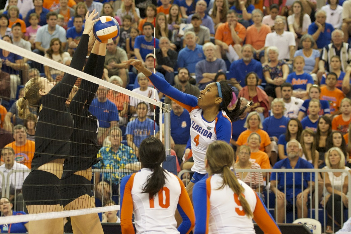 Right side hitter, Tangerine Wiggs, gets blocked by Missouri in the first set.