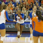 Florida volleyball players celebrate after Ziva Recek gets a kill on the outside Friday night.