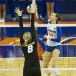 Senior Betsy Smith of the Florida Gators gets blocked by Missouri in the second set on Friday night.