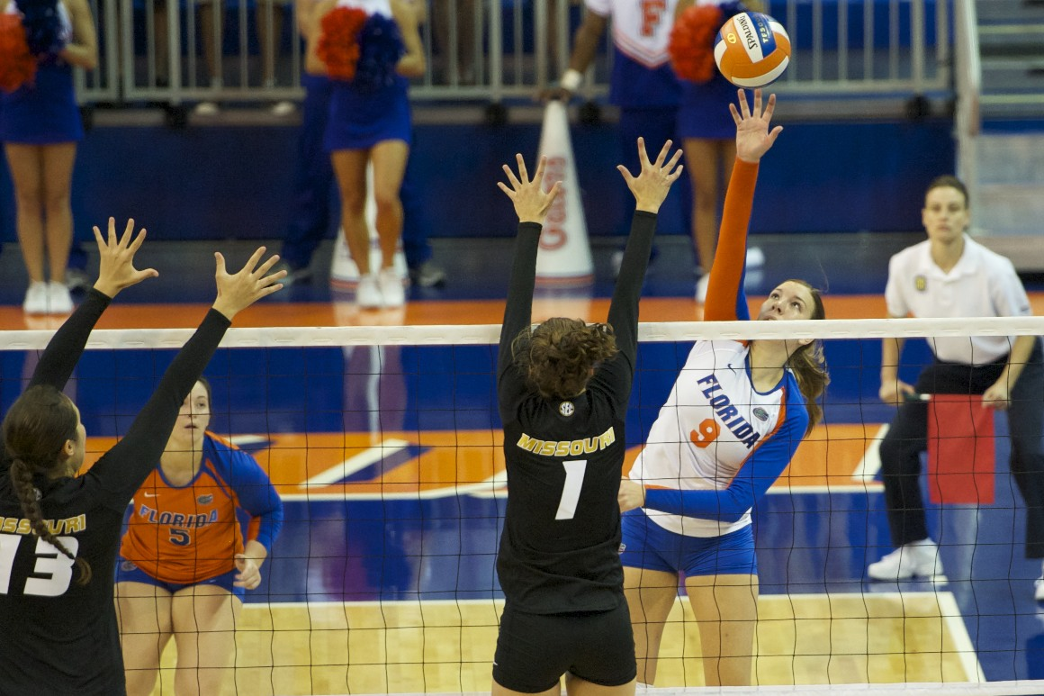 Freshman Ziva Recek tips it over the block for a Gators point in the second set, during the match Friday evening.