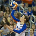 Number 8, Taylor Brauneis, serves for the Florida Gators in the third set Friday night.