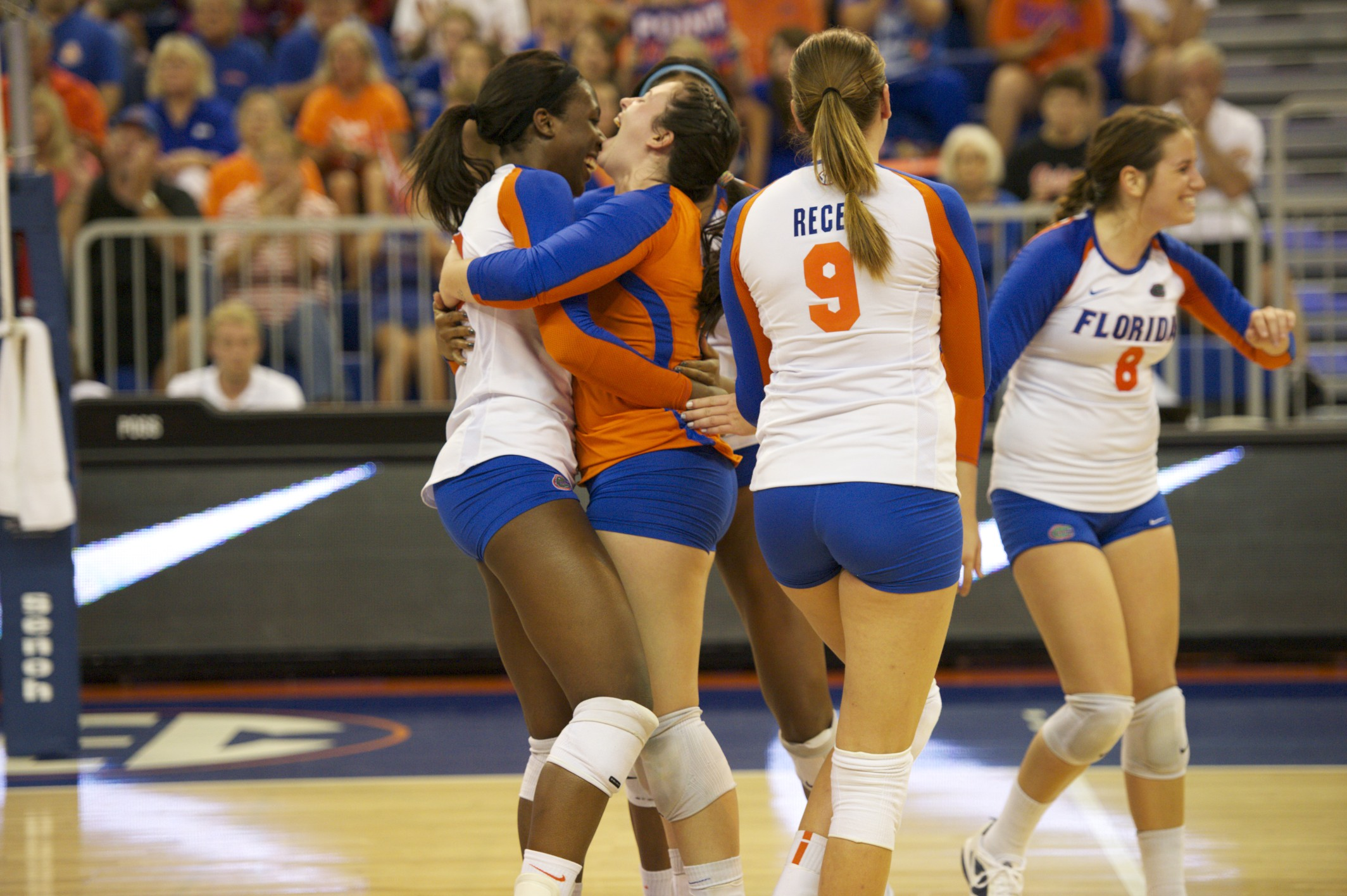 Florida celebrates after Chloe Mann blocks the Missouri setter's attempt to tip the second ball over.