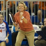 Florida head coach, Mary Wise, cheers on her team from the sidelines as Gators close out the win against Missouri Friday night.