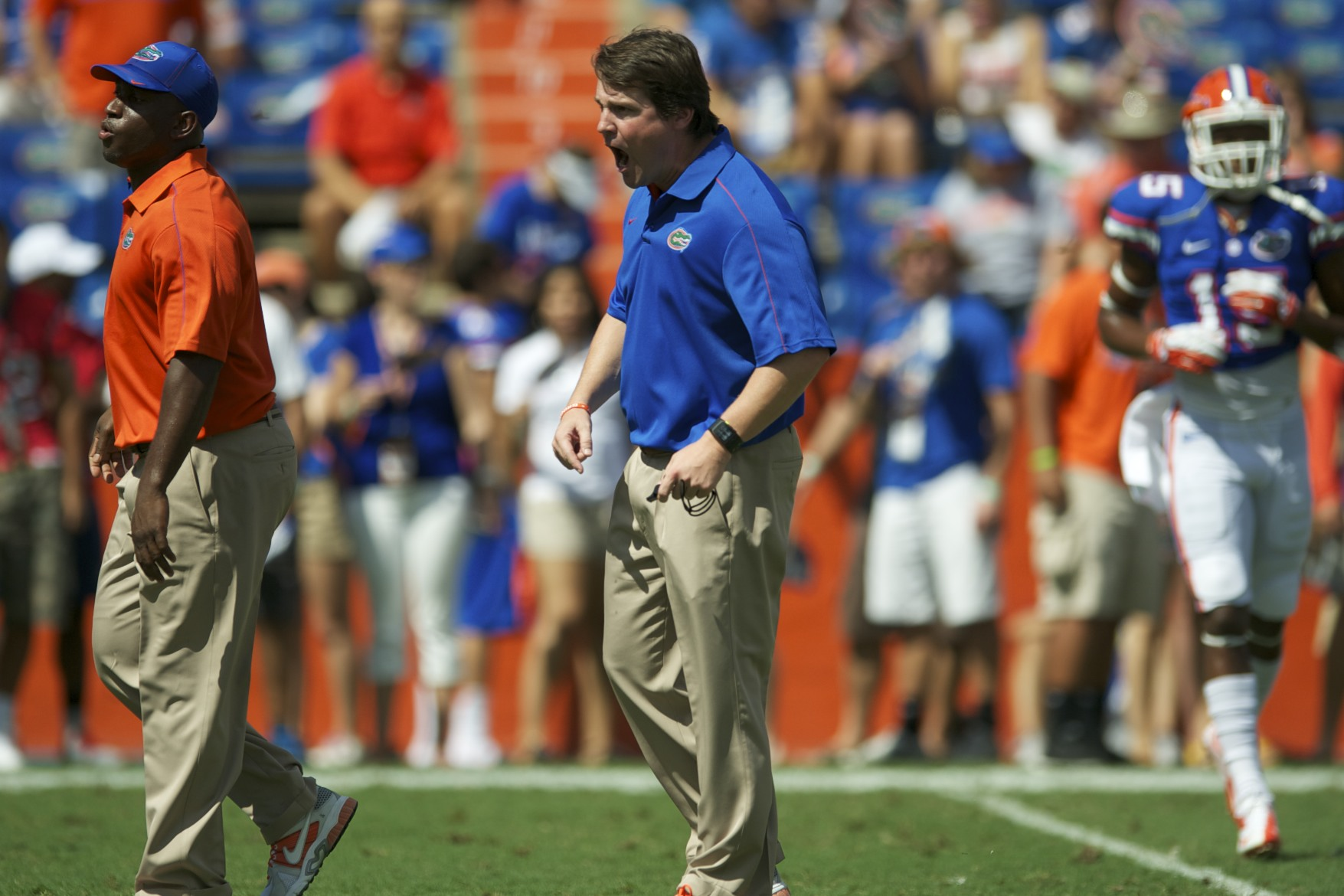 Florida head coach, Will Muschamp, coaches prior to the start of the game on Saturday afternoon.