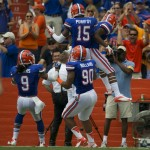 Gator teammates celebrate after a touchdown in the first half.