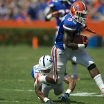 Running back Mack Brown takes a hand off from quartback Driskel for a first down for the Florida Gators.