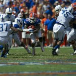 Running back Mack Brown gets a first down for the Florida Gators during Saturday's game.
