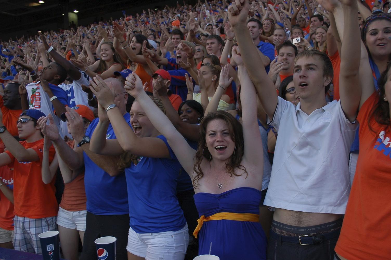 Gators fans celebrating after a Florida touchdown.