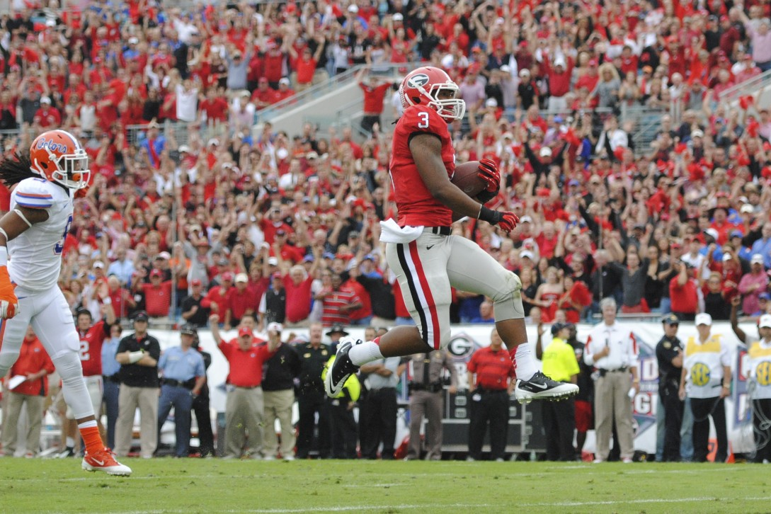 Georgia's Todd Gurley (3) gets a touchdown for the Georgia Bulldogs in the first quarter, leaving the scoreboard 7-0.