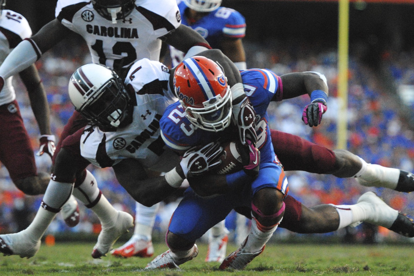 Mike Gillislee of the Florida Gators gets tackled in the second half of Saturday's game.