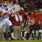 Florida's Omarius Hines runs the ball for the Gators in the second half of Saturday's game against the Georgia Bulldogs.