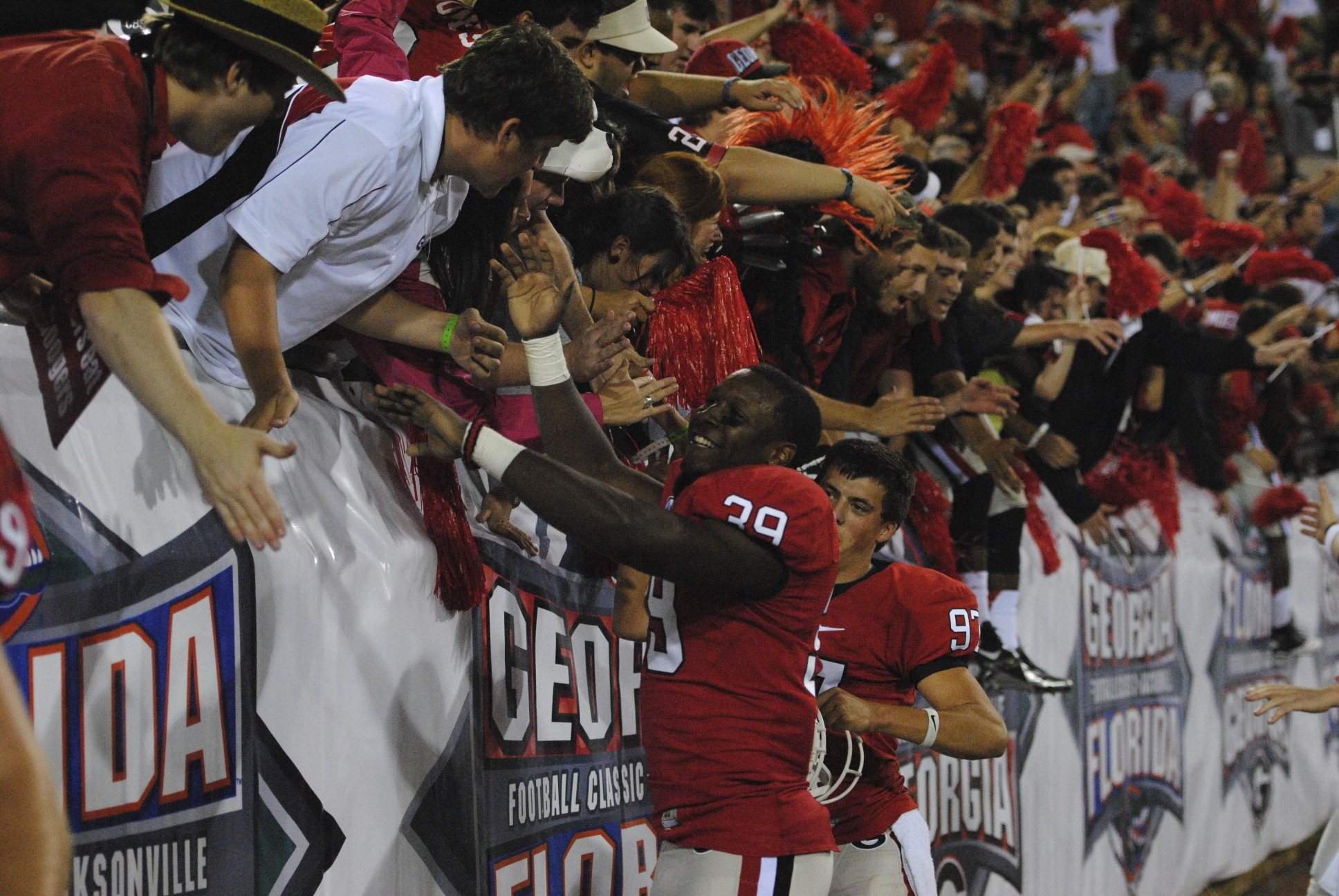 Georgia players high five their fans after the win over Florida 17-9, Saturday.