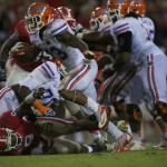 Florida's Mike Gillislee gets a first down in the second half of Saturday's game.