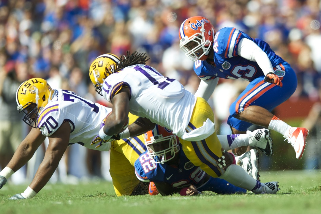 Defensive back Matt Elam tackles LSU's running back Spencer Ware to stop a first down in the first half in Saturday's game.