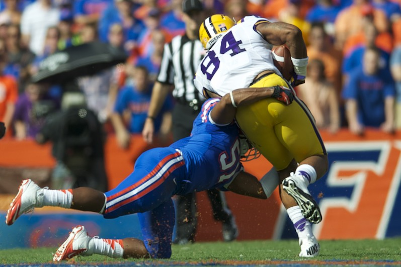 Linebacker Michael Taylor gets a tackle for the Florida Gators in the first half.