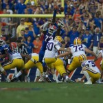 An attempt of a block by Florida's defense after LSU's first field goal to put points on the board.