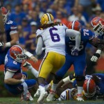 Quarterback Jeff Driskel is sacked in the first half of Saturday's game.