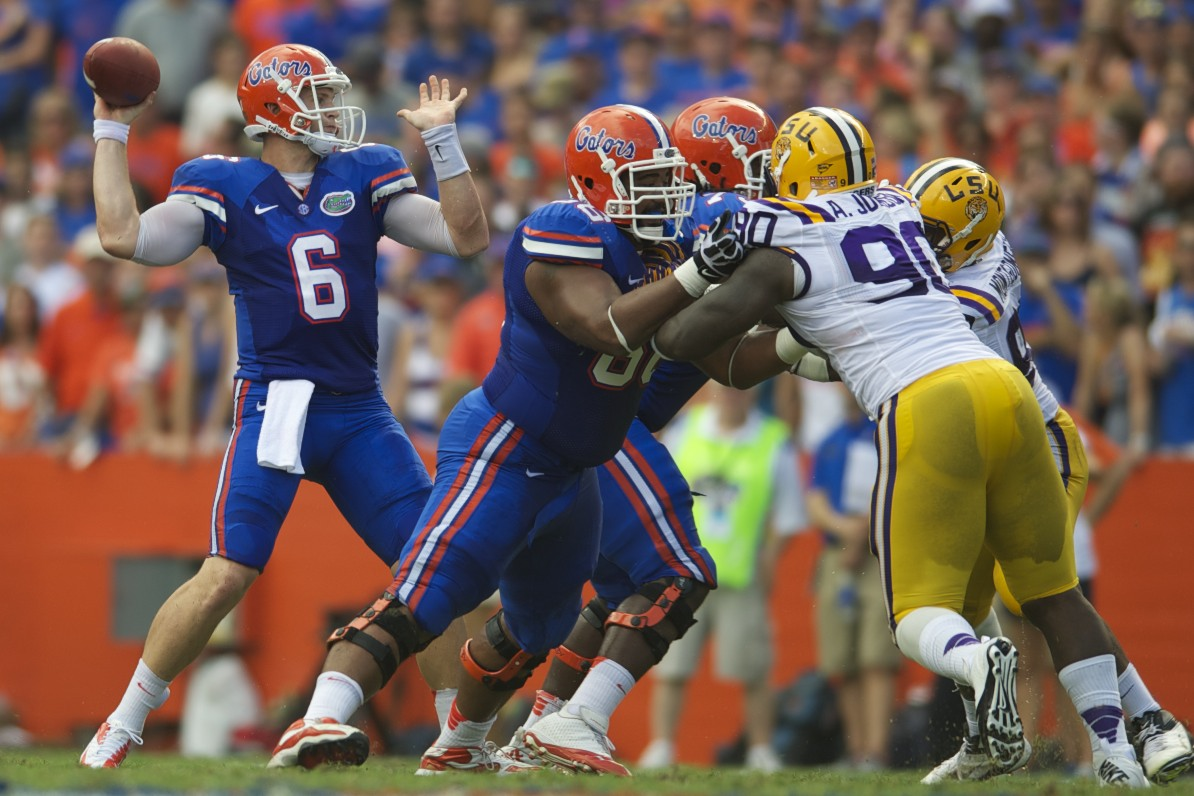 Florida players hold off LSU defense allowing quarterback Jeff Driskel to throw for a first down.