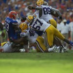 Mike Gillislee is taken down after positive yardage in the second half of Saturday's game against LSU.